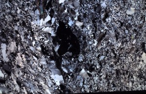 thin section crossed polarizers quartzite with shocked minerals